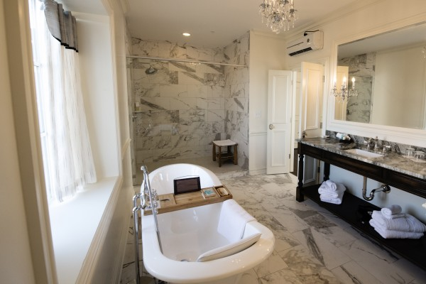 Romantic bathroom in hotel with marble tile